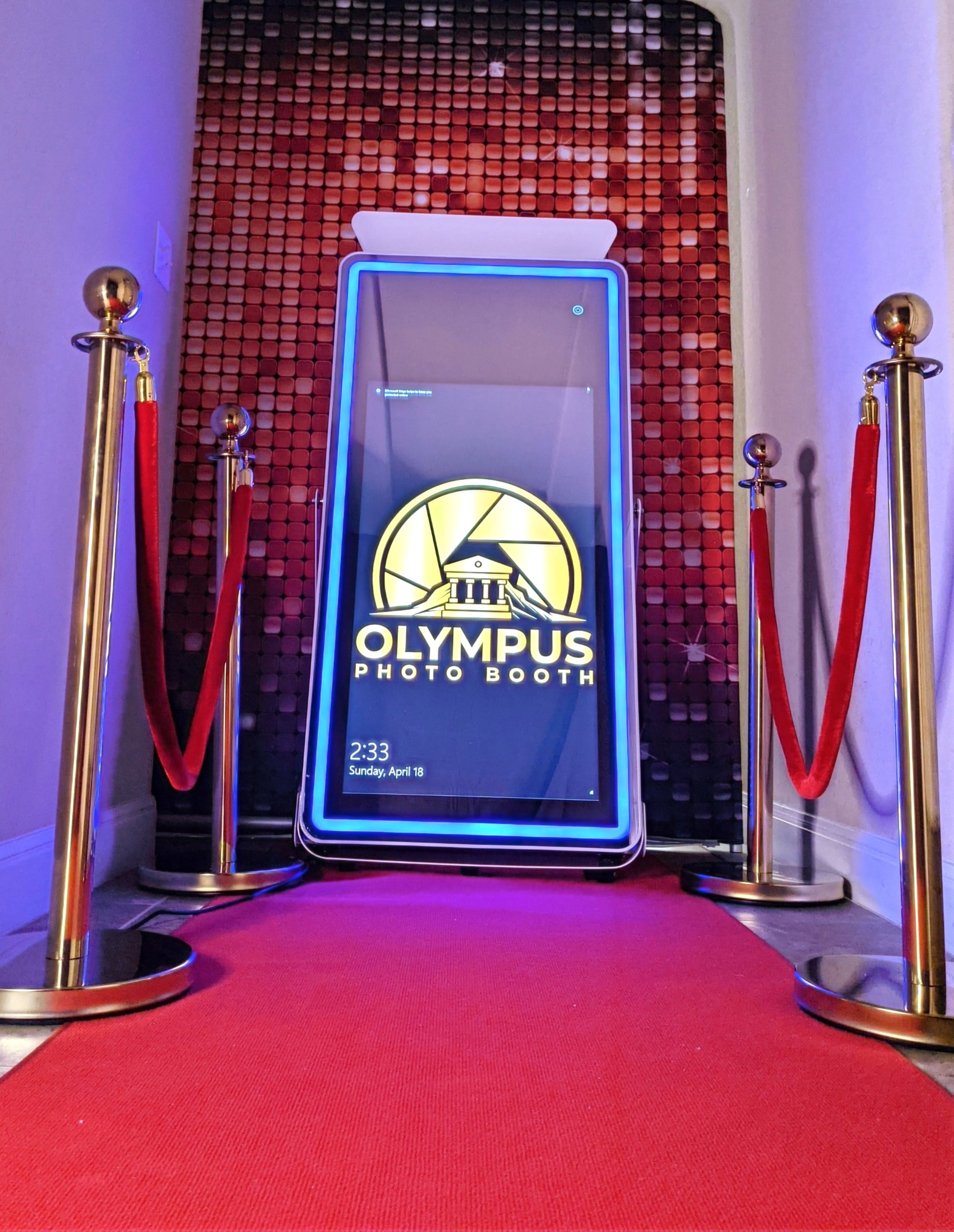 Red carpet with stanchions and mirrored photo booth